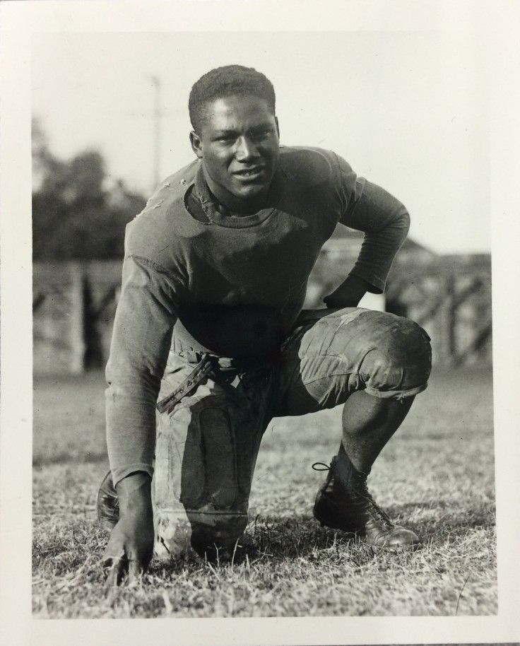 Rolland J. Curtis playing football at USC